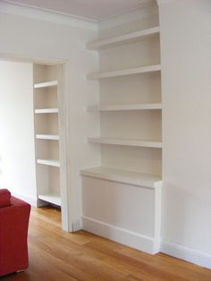 Floating shelves and cupboards. cupboards do not intrude on the lines of the chimney breast