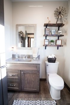 A beautiful modern farmhouse bathroom interior design complete with open shelves, natural wood cabinet and wood flooring. This modern farmhouse floor plan designed and built by Nordaas Homes, a full-service custom home builder in Minnesota. We have a variety of house plans--from single story, two story, small homes and more...all tried, tested Small Bathroom Sinks, Guest Bathrooms, Modern Bathrooms, Dream Bathrooms, Modern Bathroom Design, Bathroom Interior Design, Beautiful Bathrooms, Interior Ideas, Bathroom Ideas