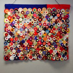 Penny rug quilt using scrap materials cut into 3 different sized circles and glued together. Great for a group project.