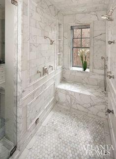 walk in, marble-clad shower