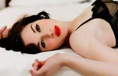 Dark hair, bright red lips