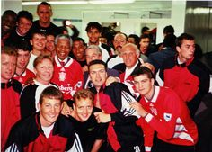 Nelson Mandela surrounded by the players and management of Liverpool FC in the dressing room in South Africa, 1994 Liverpool Fc, Liverpool Football Club, Nelson Mandela, Real Soccer, Something In The Way, World Football, College Football, Famous Celebrities, Celebs