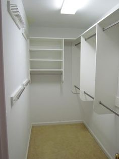 Narrow walk-in closet, rods only on 1 side