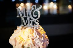 Mr. & Mrs. wedding cake toppers can be purchased on Etsy.com