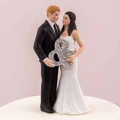 Perfect for the modern couple, this sweet cake topper couple is trend savvy as they pose with a marquee style ampersand. The groom looks dapper in an all black tux and the bride is oh-so-elegant in her sleek, tailored dress. Wedding Cake Prices, Unique Wedding Cakes, Beautiful Wedding Cakes, Wedding Cupcakes, Wedding Ideas, Wedding Stuff, Wedding Decor, Wedding Planning, Mr Mrs