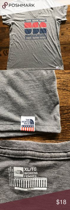 North Face retro T-shirt USA slim fit V neck XL Cute and comfy V neck T-shirt from North Face; stitched logo on bottom hem; USA theme on front and solid gray back; Womens XL fitted (slim fit) North Face Tops Tees - Short Sleeve