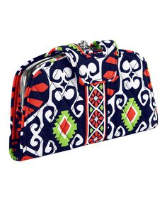 Vintage-inspired and sealed with a kiss lock, this soft cotton wallet boasts one of Vera Bradley's highly coveted retired patterns. The secure closure opens to reveal all kinds of interior organizing, including a clear compartment divider that provides total visibility. Note: This item features a retired pattern.