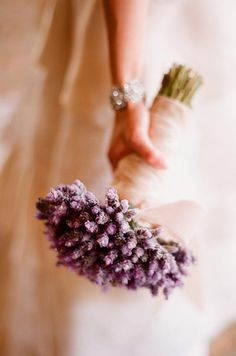For a budget-friendly bouquet, bundle a single type of flower at a uniform height and wrap with stems with ribbon.