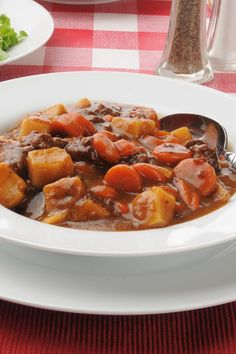 Recipe including course(s): Entrée; and ingredients: bay leaf, beef broth, beef stew meat, black pepper, carrots, celery, flour, garlic, onion, paprika, potato, salt, Worcestershire sauce