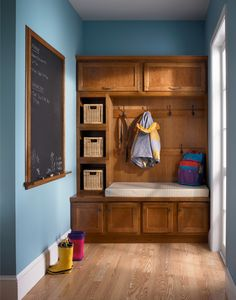 built in bench with coathooks, basket shelves, and chalkboard
