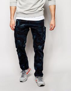 """Cargo trousers by G Star Camo printed cotton Contains stretch for comfort Low rise Zip fly Cargo style pockets Tapered leg Slim fit - cut closely to the body Machine wash 100% Cotton Our model wears a 32""""/81 cm regular and is 185.5cm/6'1"""" tall"""