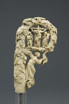 Ivory pastoral staff head depicting the Virgin and Child between two Angels and the Crucifixion - Paris, France c1350 (Victoria & Albert Museum)