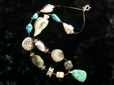 28 Necklace w/turquoise, jasper & metal adornments.