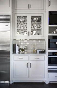 Linda McDougald Design - Kitchen nook with white flat center panel kitchen cabinets, TV, ...