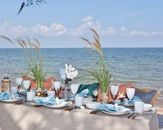 Dining alfresco just got dreamier. A linen in sandy shades pairs with blue accents reminiscent of crystal-clear waters for a welcoming seaside setting. Centerpiece design: Lillie Jane #southernladymag #tablescapes #tablescape #tabletopinspo #alfresco #summerinthesouth Dinner Party Table, Beach Wedding Reception, Southern Ladies, Crystal Clear Water, Seasonal Flowers, Gifts For New Moms, Blue Accents, Beach Day, Best Part Of Me