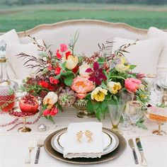 Like the spread out structure of this arrangement for centerpieces.  Colors are nice.  I like the color pop of the hot coral-pinks. But no yellows - stay away from citrus.