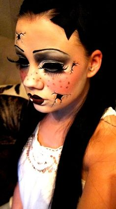 creative, dramatic and slightly disturbing doll-like makeup.