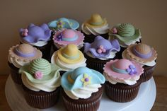 Hat cupcakes. Could have a mannequin head wearing a fancy hat and hat boxes for display.
