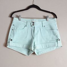 """Turquoise denim cuffed shorts Very cute turquoise colored denim shorts. They are cuffed on the bottom and in overall good condition. Slightly faded in color. A fun change from regular colored denim shorts! """"Life in progress"""" brand from Forever 21. ❌no trades. Forever 21 Shorts Jean Shorts"""