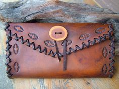 Hand tooled Leather Wallets by:  www.daughterofthesun.etsy.com
