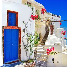i love the colours of the blue door and the white building together.