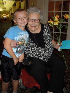 Everett Sjolseth, left, brings flowers to a nursing home resident.