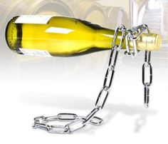Chain Wine Bottle Holder - a gravity defying eye catcher, and a great way to show off your vino. Made from welded chain links and cleverly designed so as to balance perfectly when you add your wine bottle of choice, it's like having a piece of installation art on your dining table.