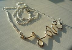"""love my new """"love"""" necklace! is made in your choice of sterling silver or gold filled :)"""