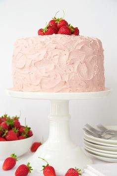 Strawberry Layer Cake - Layers of tender, moist cake sandwiched between a double dose of strawberries - fresh strawberry buttercream and strawberry jam! Strawberry Layer Cakes, Homemade Strawberry Cake, Strawberry Buttercream, Strawberry Jam, Two Layer Cakes, Cake Layers, Easy Homemade Recipes, Dinner Party Recipes, Rustic Cake