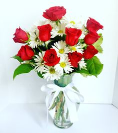 Red rose vase with daisies
