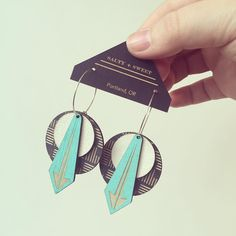 Leather & laser-cut wood come together for a pair of cool modern earrings from @saltyandsweetdesign. by homespunindy