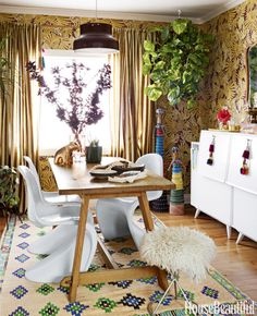 Paint the town gold! And by town we mean your dining room. And by paint we mean use wallpaper. Click through for more stunning dining room ideas — we dare you not to be inspired.