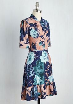 Depict your style dexterity with the painterly flowers displayed on this vintage-inspired dress! Brought to you by Closet London, this navy, teal, and rosey mauve delight is arranged with a gathered, high neckline, puffed half sleeves, a back keyhole topping a golden zipper, and a ruffled hem - features that accentuate your posh artistry.