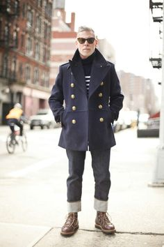 Nick Wooster wearing a Double Breasted Pea Coat with Brass Buttons, striped Tee, Loose Cuffed Jeans, and Brown Work Boots. Men's Fall Winter Fashion.