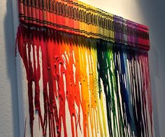 Instantly liven up a drab wall by hanging some melted crayon art. An entire box of crayons is laid out over a white canvas to create a visually stunning piece that pleases the senses while giving the room some nostalgically artistic life. Crayon Painting, Crayon Art, Melted Crayon Canvas, Rustic Pendant Lighting, Pendant Lights, Playroom Art, Melting Crayons, Inspirational Wall Art, Wall Colors