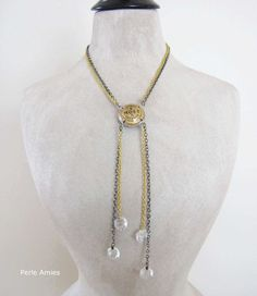 A classy and unique Champagne necklace with two MOET champagne caps welded together back to back. The Champagne cap hangs in a double gold and black chain. The chain is adorned with vintage French chandelier crystals.