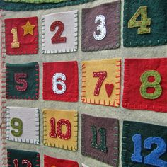 Advent Calander Penny Mat style featuring Santa and a Snowman  http://www.etsy.com/listing/85965988/advent-calendar-penny-rug-style