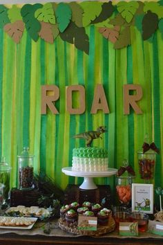 Cool backdrop at a dinosaur birthday party! See more party planning ideas at CatchMyParty.com!                                                                                                                                                      Más