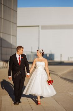retro themed dress - tea length with red shoes and birdcage veil