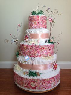 Made this Happy Tree Diaper Cake for my niece! Matched perfectly with her room.