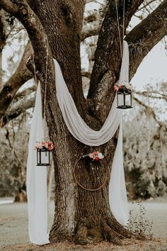 Lush Rustic Jensen Beach Wedding at The Mansion at Tuckahoe Draped white linen, hanging lanterns and floral wreaths made for a dreamy, rustic ambience at this outdoor ceremony Image from Brandi Toole Photography Bodas Boho Chic, Cheap Wedding Decorations, Table Decorations, Hippie Wedding Decorations, Floral Decorations, Hanging Decorations, Outdoor Decorations, Wedding Centerpieces, Spring Wedding
