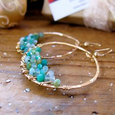 Caribbean Water Hoops (Peruvian Opal and Gold) - so pretty! from @ delia langan