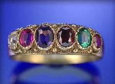 An enamel and gem-set 'regard' ring, c.1835; the first letters of each stone spell out the word 'regard' (e.g., ruby, emerald, garnet, amethyst, ruby, diamond – NB this ring has been photographed upside down). (Sotheby's)