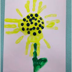 Lena S. and I did this DIY craft with the kids at the After School Program. They used their hands for the flower and dots! It went great, and is the perfect Mother's Day card!