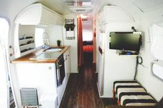 The Wiegand family chose simple black and white to give the impression of more space in their Airstream Airstream Living, Airstream Campers, Airstream Remodel, Airstream Renovation, Airstream Interior, Trailer Interior, Remodeled Campers, Trailer Remodel, Vintage Rv
