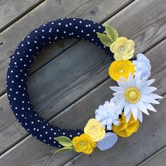 This felt daisy pairs beautifully with the navy polka dot wreath! A great wreath for spring!