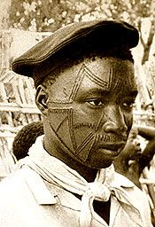 "Africa | Spanning the facial area above the mouth and across the cheeks and nose, lichumba (""deep angles"") marked nearly all Makonde (Mozambique) men and  women in the past. These markings also extended to the body. 