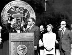Harold Washington takes the oath of office as Mayor of Chicago, administered by Circuit Judge Charles Freeman. At right are Cardinal Joseph Bernardin, outgoing Mayor Jane Byrne and her husband, Jay McMullen.