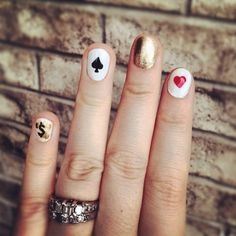 YUP, definintely doing a Royal Flush manicure next time.  I think I will use gold as the base color and the black club cards as the design.