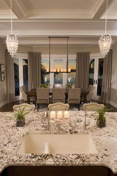Love the chandeliers, the granite and the windows (not crazy about the window treatments--does it really need any?) and what about that VIEW?  GORGEOUS!